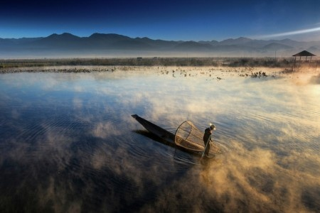 Aung Pyae Soe: The Fisherman was catching fishes from the lake at misty morning