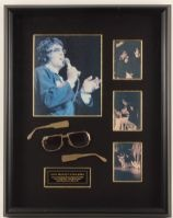 Elvis Presley's stage worn sunglasses that he broke during his July 22, 1974 concert at the Las Vegas Hilton while giving a karate demonstration on stage. This pair of Neo-Nautic style sunglasses are framed in a shadow box style display with photographs of Elvis on stage wearing the glasses.