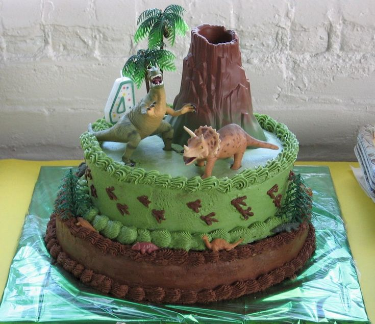Dinosaur Cake. Note: I had to pin this from google images, there was no actual link to the picture.