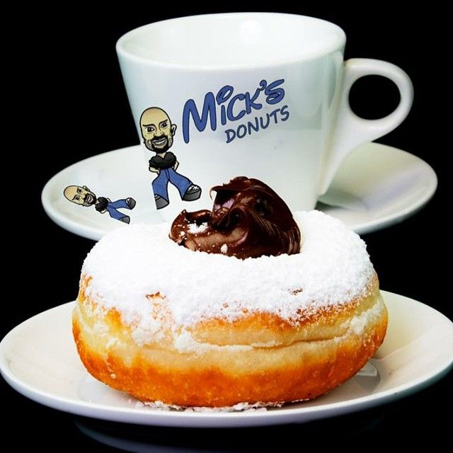 """hi everyone :) #MICKS PLACE would like to take this opportunity inform you that the #Donutella was named by our #awsome customers in a competition which was held on our Facebook page , """"#DONUTELLA"""" has since then gone nationally #Viral ,and has now been #registered under """"#Micks Donuts"""", We have simply no idea on how or what is happening , it has us all basically #GobSmacked :) #MICKSPLACE is on #Victoria Drive in #Thomastown and is the ONLY place that sells the now #viral and #famous…"""