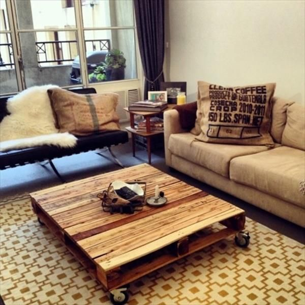 In this picture a simple DIY wooden pallet table is shown under this the wheels are attached which makes easiness for you that you can move it easily every corner of the room.