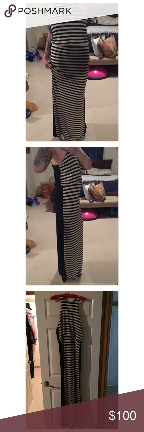ABS Allen Schwartz BOMB sexy dress Breathtaking ABS Allen Schwartz dress. Only worn for 2 hours and excellent condition. Flawless and timeless look. Black and cream striped front with black back. Open slit below the knees in back with halter neck and slit closure. (Shown in 4th picture). ABS Allen Schwartz Dresses