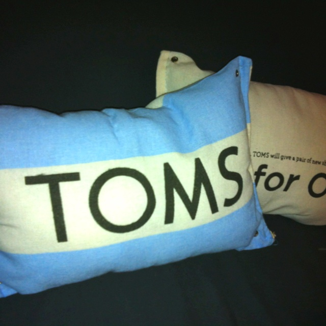 Toms pillows bought a USD2 bag of pillow stuffing at hobby lobby, stuffed my Toms flags and sewed ...