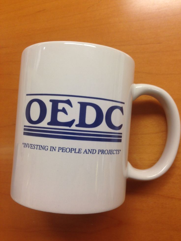 """OEDC """"Investing in People and Projects""""   (Omaha Economic Development Corporation), offices on N 24th Street in North Omaha, coffee mug."""