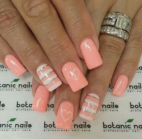 Pink nails. Peach color nails with silver and white stripes. Pretty. Heart.