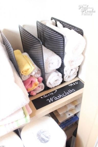 A file sorter fits onto most shelves and immediately creates stackable compartments for washcloths — no need to worry about toppling.