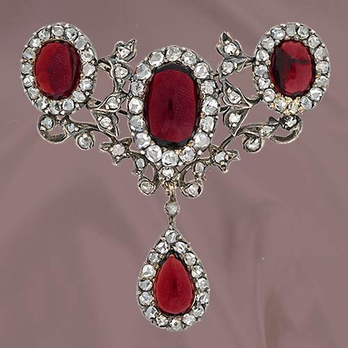 Early 19th Century Garnet and Diamond Brooch.Beautiful silver over 14K yellow gold pin highlighting three oval cabochon garnets (7.45 carats) accented with rose cut diamonds (82 total, 1.50 carats total weight) in a delicate foliate motif throughout with a drop pear shaped garnet (1.50 carat) surrounded by rose cut diamonds.Beautiful Silver, 14K Yellow, Diamonds Brooches, Yellow Gold, Brooches Beautiful, 19Th Century, Gold Pin, Century Garnet, Antiques
