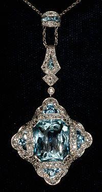 Carved aquamarine Deco diamond very rare pendant (figures carved in large aquamarine) platinum set 1920c (hva)
