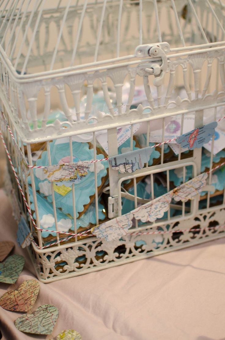 A bird cage with cookies for favours to give away