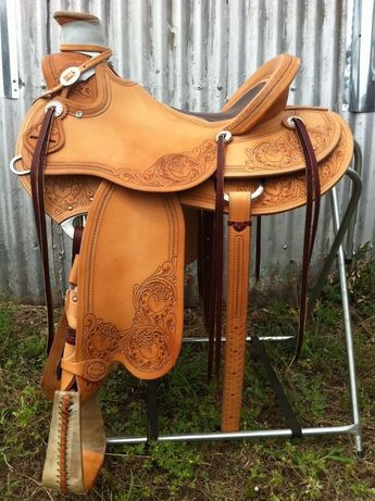 The Custom Wade Saddle Below Has A Loop Seat. Exposed Stirrup Leathers, Hand Tooled Single Rope Border, Hand Carved Oak Housing And Fork, 1/4 Leather Oak ...