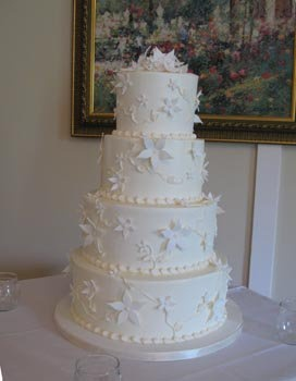white wedding cake with flower accents
