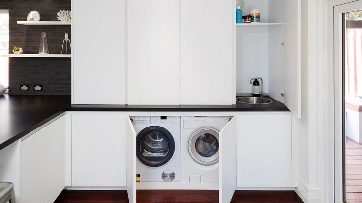 All the appliances are hidden away behind joinery. Created by Retreat Design.