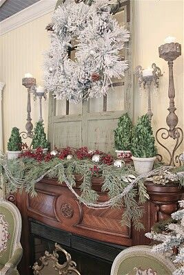 Christmas mantle - love the use of the old wooden window as the backdrop on the mantle!