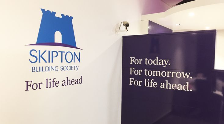 Skipton Building Society logo on wall and Acrylic lettering tagline. This addition to the space transforms it from a boring wall into an inspirational showcase of branding and company values. By Space3.co.uk