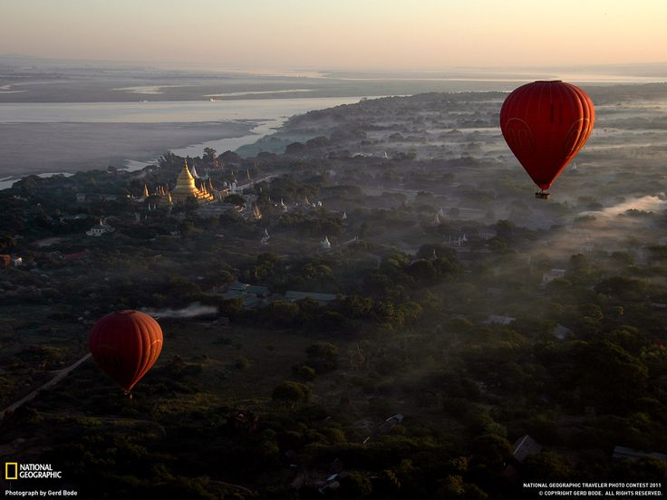http://photography.nationalgeographic.com/photo-of-the-day/hot-air-balloons-bagan/  Floating over the 2,300 temples at dawn in Bagan, Myanmar,
