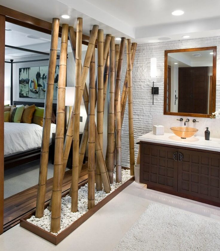 Natural bamboo room divider in an eclectic open plan bedroom and en suite | NONAGON.style