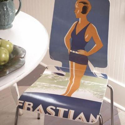 Use Mod-podge to update chairs with vintage posters.