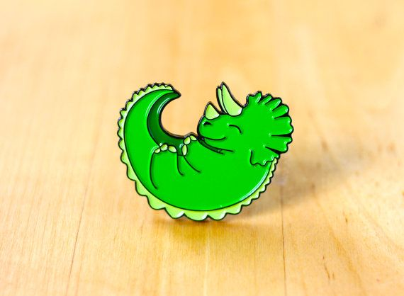 One triceratops enamel pin, perfect for dinosaur lovers.  - THE NITTY GRITTY - ✎ One 1.25-inch (32mm) soft enamel pin, made from my original