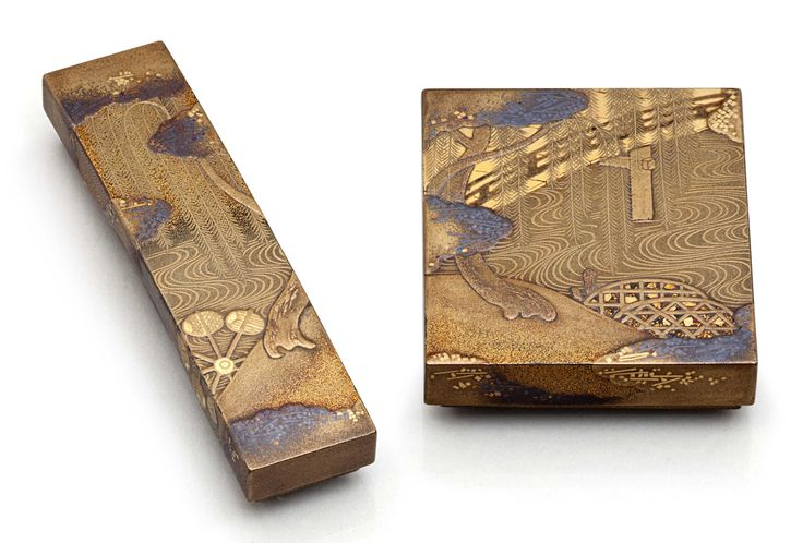 A set of miniature lacquer boxes for poem papers Meiji period (late 19th century), by Zohiko (Nishimura Hikobei) Decorated in gold hiramaki-e, takamaki-e and kirikane with Uji Bridge with willows and water wheel; fitted with variously colored papers for inscribing poems (tanzaku) 3in. (7.6cm.) x 3/4in. (1.9cm.) and 2in. (5.1cm.) x 1¾in. (4.5cm.) With original box titled on hina kazari ryukyo maki-e shikishi hako tanzaku hako, and signed Heian Zohiko zo