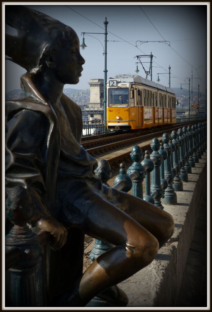 Little Princess Statue and famous Tram Line 2 in Budapest, Hungary (March 2014) - Photo taken by BradJIll