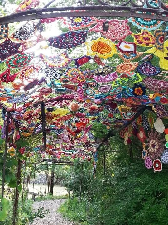 """A crocheted flower tunnel for the festival """"Le Lot et la Laine"""". Musée de Cuzal, France - July 2013."""