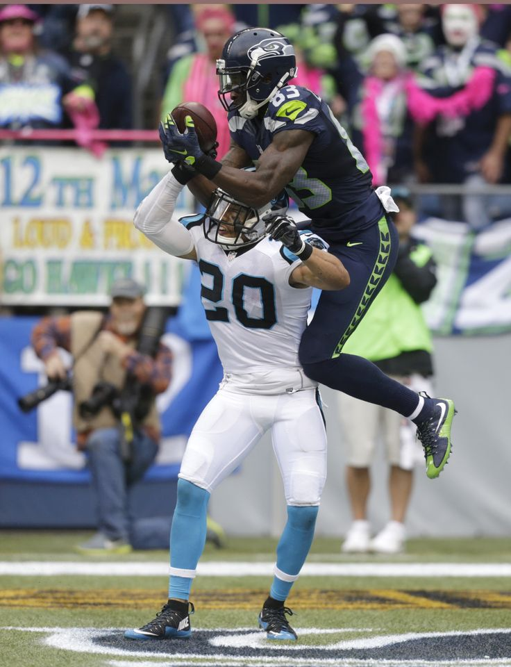 Not so fast Kurt Coleman! The Panthers safety missed out on a would-be interception when Seattle Seahawks WR Ricardo Lockette launched himself into the air to snag this pass from Russell Wilson. (AP Photo/Stephen Brashear)