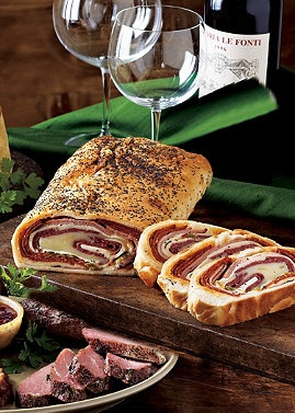 This hearty bread roll is packed with ham, cheese, and Italian herbs, making it a holiday favorite! Normthompson.com #Appetizer #Food