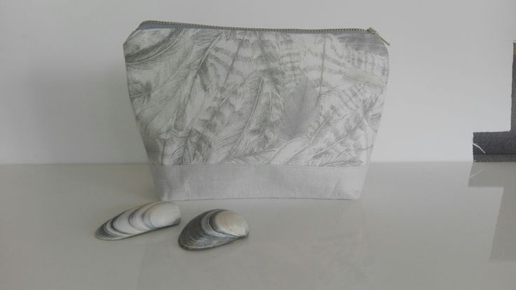 Hand made in New Zealand from pale grey linen and feather print Liberty of London Tana Lawn fabric.