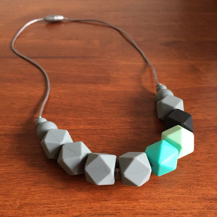 Silicone Teething Necklace- Fussy Little Fox Hexagon Teething Necklace in grey, turquoise, mint and black on silver nylon cord with silver safety catch. $30 + Free Shipping within Australia. Visit Fussy Little Fox on Facebook to see more or email fussylittlefox@gmail.com to purchase.