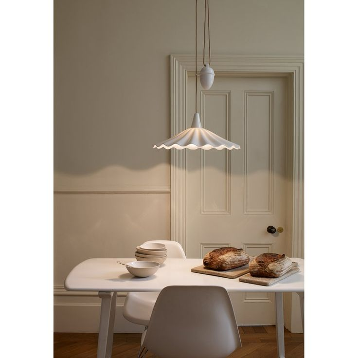 An exquisitely hand crafted bone china pendant light, with a shade that has been inspired by the rolling ocean waves. Bone china has been heated & moulded to create this eye catching Christie light, available either as a Rise & Fall or Pendant light. Our trademark sand & taupe braided cable and bone china ceiling rose finish the design off beautifully.