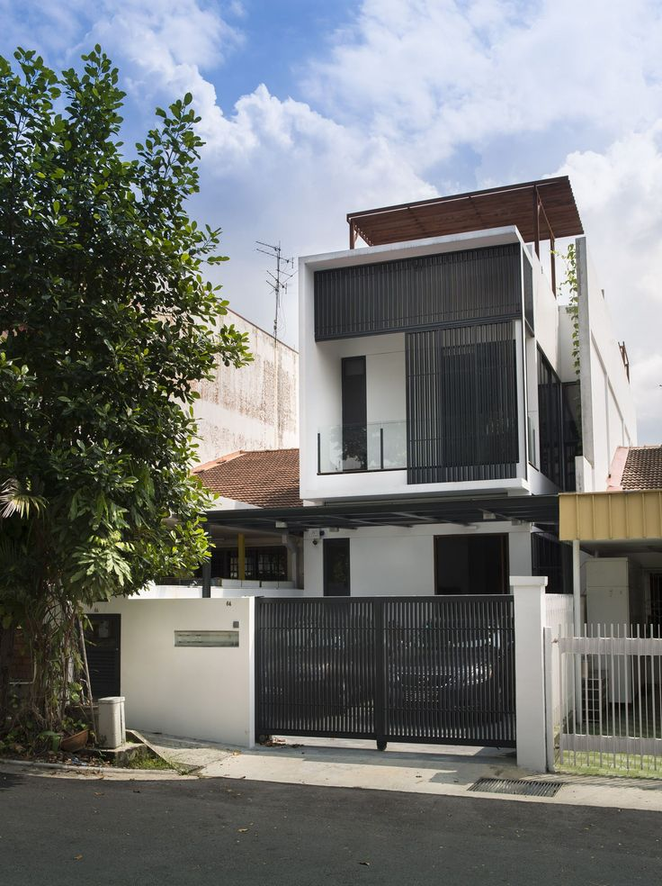 Built by ADX Architects in , Singapore with date 2012. Images by Edward Hendricks. The house is an inter terrace house in the lush verdant surrounds of Thomson suburbs, facing the fields of James Cook...