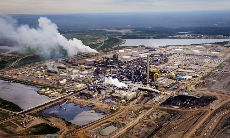 The Syncrude Canada Ltd. base plant stands in this aerial photograph taken above the Athabasca Oil Sands near Fort McMurray, Alberta, Canada, on Wednesday, June 19, 2014.