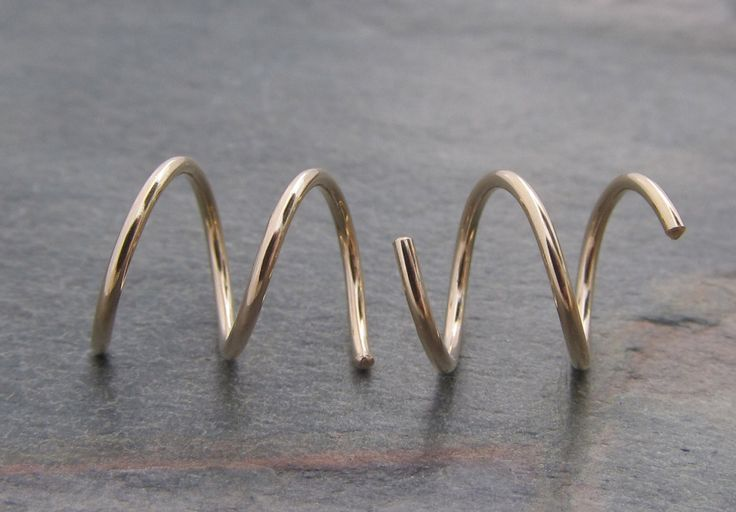 Bet these wouldn't murder my neck when I try and sleep.   7 mm Hoops for 2 Side by Side Ear Piercings in 14/20 Gold Filled