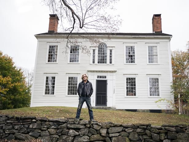 Daryl stands atop the stone fence in front of his restored historic home.Farmhouse Restoration, Daryl Hall, Restoration Overhall, Daryl Restoration, Colonial House Restoration, Daryll Restoration, Daryl House, Darylls Overhall, Diy Network