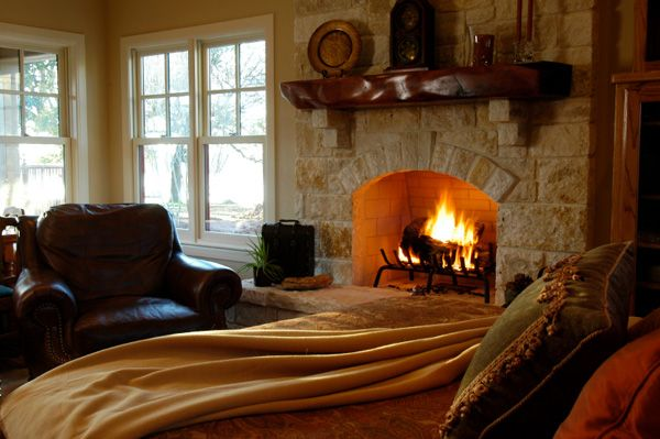 Fireplace in bedroom with hand scraped timber mantle
