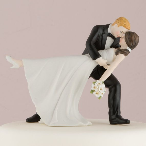 This Couple is wrapped in a romantic embrace of dance. The Brides pretty pony tail, simple dress and rhinestone shoes give this Cake Topper a lovely modernized twist on a classic pose. Dimensions: -4 1/8 x 4 1/8 H  We can change the hair color for you. Simply select your customized color change option at checkout(Change groom hair color, Change bride hair color, or Change both) and let us know in your notes what color changes you need. The existing colors are as pictured. If you ord...