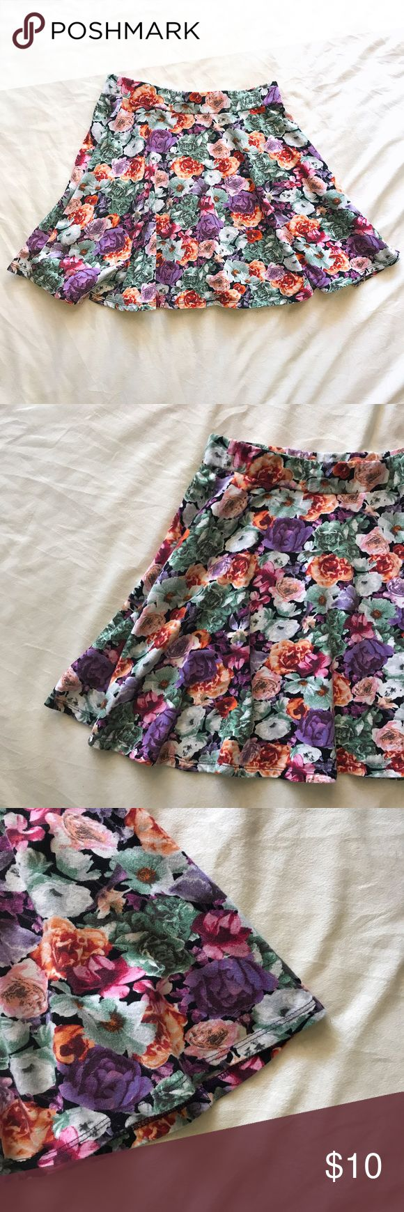 "Floral Mini Circle Skirt Beautiful floral print circle skirt featuring floral print and an elastic waistband. 15"" long, 27"" waistband. Ships next day. Skirts Mini"