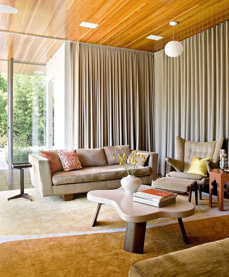 Floor to ceiling curtains wood paneled ceilings