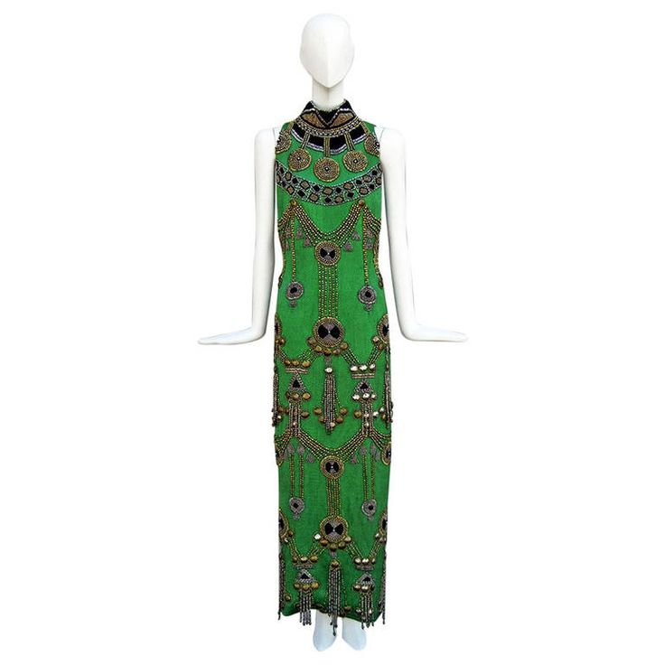 Rare 1990 Versace Atelier Egyptian Style Beaded Gown | From a collection of rare vintage evening dresses at https://www.1stdibs.com/fashion/clothing/evening-dresses/