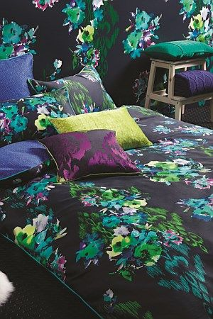 This radiant watercolour floral adds vibrancy to any bedroom.  Bettina's eclectic combination of bold. Abstract flowers and striking ikat motifs reflect the trend for design fushion.