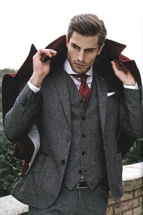 Opt for comfort in a dark red overcoat and a grey wool three piece suit.   Shop this look on Lookastic: https://lookastic.com/men/looks/overcoat-three-piece-suit-dress-shirt/14361   — Burgundy Overcoat  — White Dress Shirt  — Burgundy Polka Dot Tie  — White Pocket Square  — Dark Brown Leather Belt  — Grey Wool Three Piece Suit