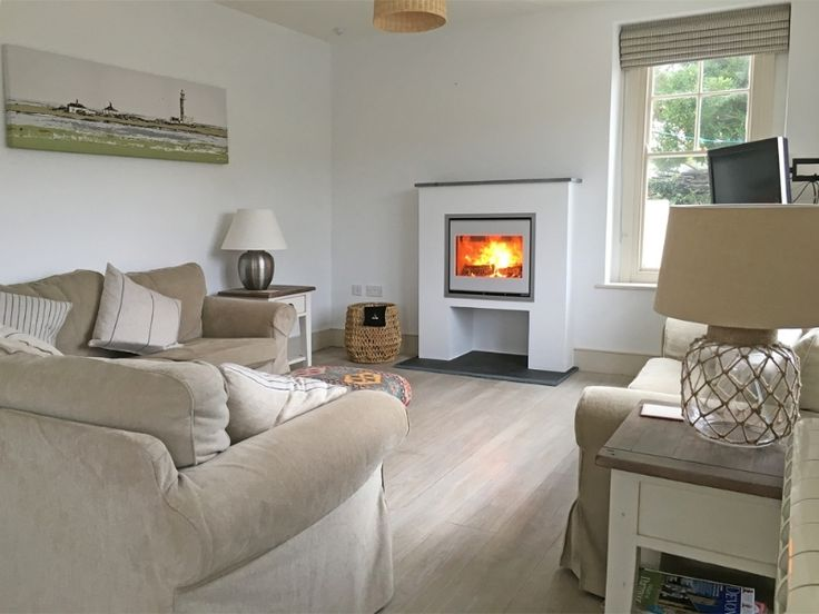Kernow Fires Scan 1001 in white stove installation in Cornwall. #kernowfires #scan #stove #woodburner #install #fireplace #inset #white #livingroom #contemporary #modern #redruth #wadebridge #cornwall