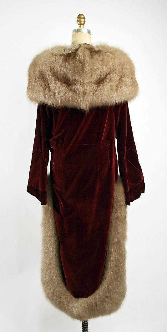 Evening coat (rear view) Date: ca. 1928 Culture: French Medium: silk, fur Dimensions: Length at CB: 58 in. (147.3 cm) Credit Line: Gift of Albert J. Cameron, Ralph Alexandre and Alec S. Alexandre, 1980 Accession Number: 1980.337