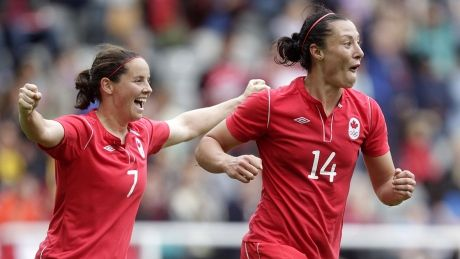 Canada's Melissa Tancredi (R) celebrates with teammate Rhian Wilkinson after scoring her team's second against Sweden during the London 2012 Olympic Games women's football match at St James' Park, Newcastle upon Tyne, England, on July 31, 2012. AFP PHOTO/GRAHAM STUART (Photo credit should read GRAHAM STUART/AFP/GettyImages)