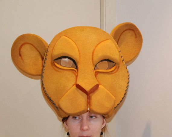Nala Lion King headdress is designed to be comfortable and light on the head of the actor.  This adult Nala mask has ochre and light brown tones, which makes the main lioness look beautiful on stage.  The size of the mask is perfect for both kids and adults. If you need a very small size we can make it without problem.  You can also use this headpiece to represent Sarabi in your Lion King musical.  In stock ready to ship  - We work with middle schools, high schools, small community theatres…