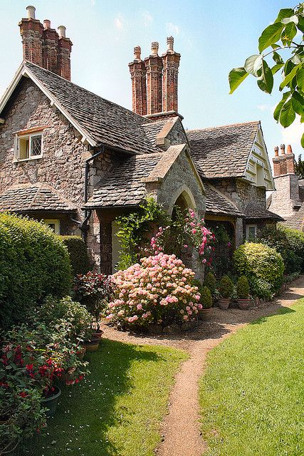 Blaise Hamlet Cottage.... well if you have a bunch of chimneys like this gorgeous home then you pretty much have built in curb appeal, but it never hurts to always add some nice evergreen shrubs and beautiful flowers too!!