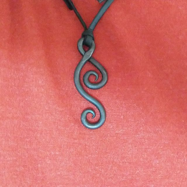Comes supplied with a high quality elk leather thread. A hand forged Leaf pendant