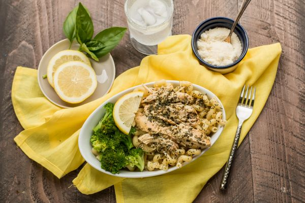 Slow Cooker Lemon Pesto Chicken. This tangychicken and saucego great over pasta or rice, and this meal is freezer meal friendly!