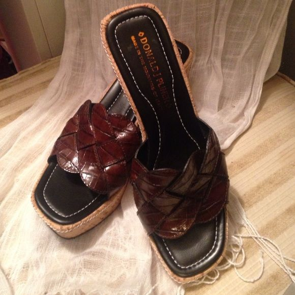 Donald J. Pliner Brown Wedge Sandals This is a pair of Donald J. Pliner ladies wedge sandals that are in pristine condition.  Let me know if you have questions. Shoes Wedges