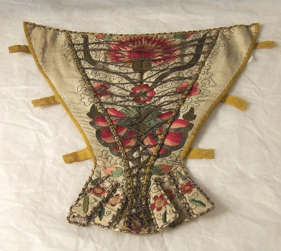 stomacher, 1740-1750 | Notice the faux lace-up front and how the silver braid is applied over the embroidered design.